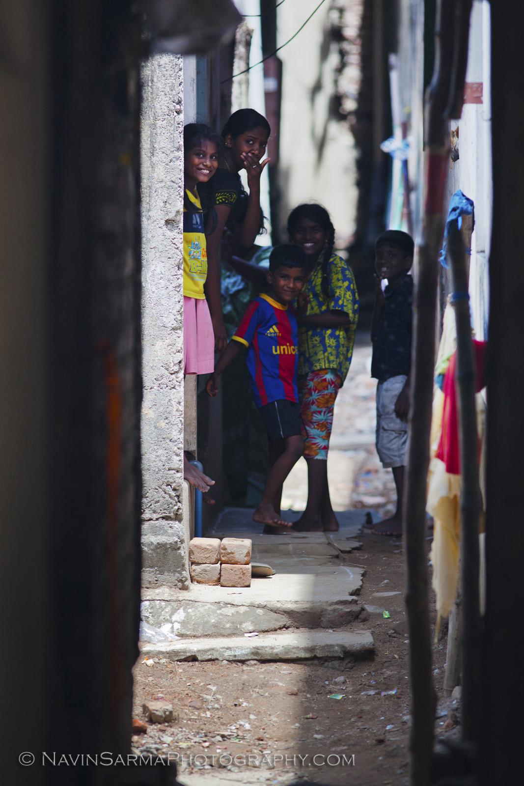 Curious children look down an alley in Chennai