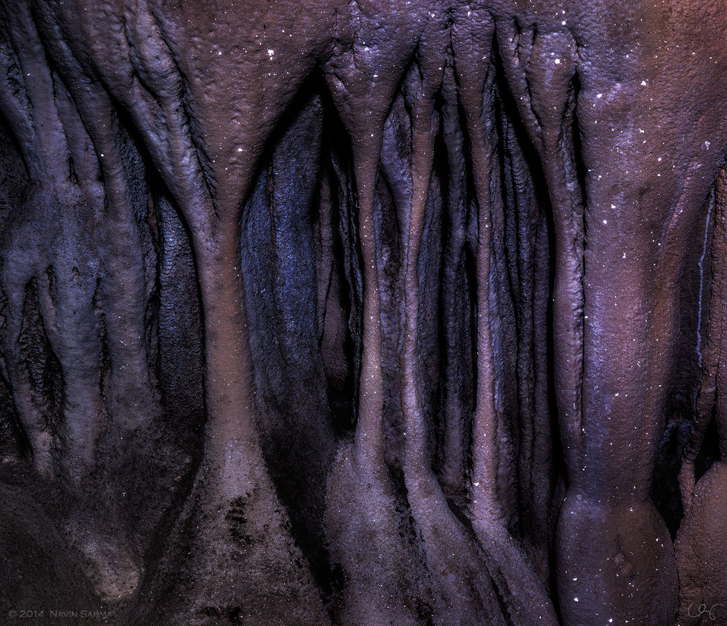 Stalactite and stalagmites form organic formations topped by the twinkle of calcite
