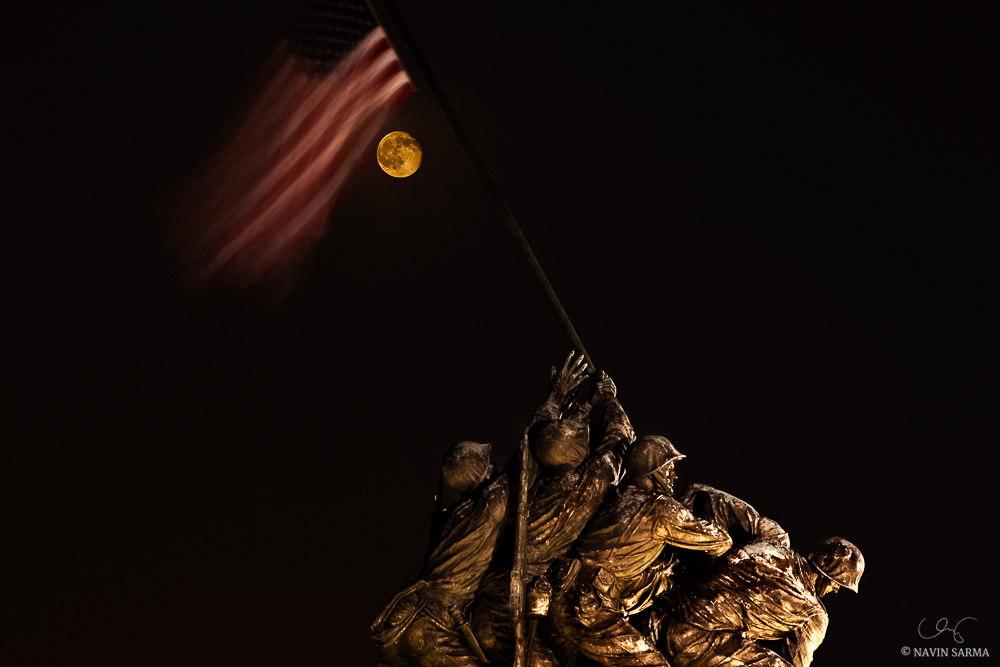 The super harvest moon rises behind the Iwo Jima Memorial in Arlington