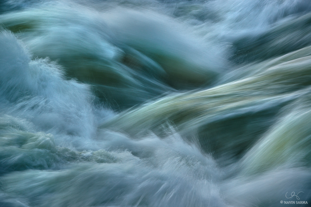 The rapids of Great Falls weave water in and out, and into interesting shapes
