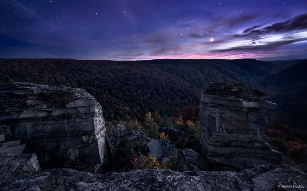 Venus shines brightly during twilight over autumn trees at Lindy Point, Blackwater Falls State Park