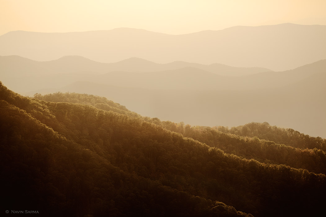 Rolling hills are lit by the sunset at the Shenandoahs