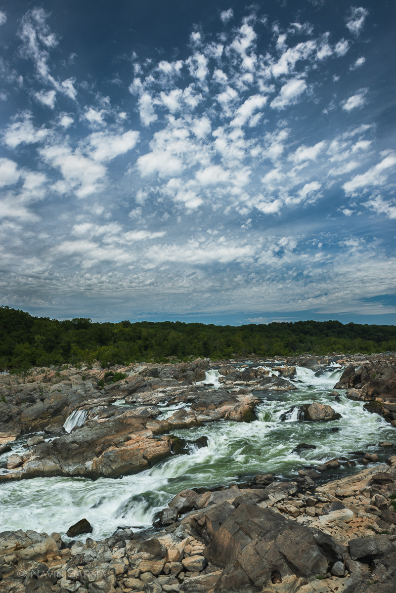High clouds pass over the waterfalls during midday at Great Falls National Park on the Maryland side