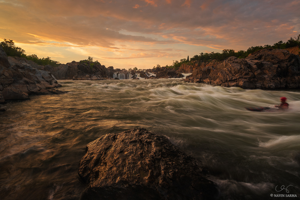 A kayaker battles with the raging Potomac at sunset after a stormy afternoon at Great Falls, VA