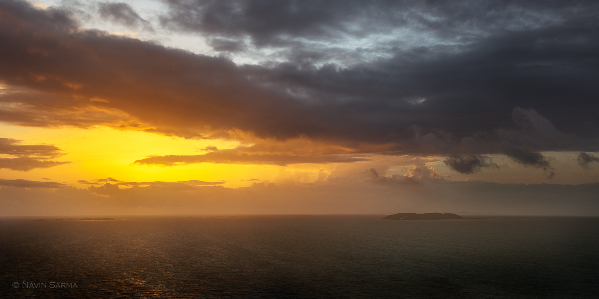 The sun pierces through clouds and shines on the islands off of the northeast coast of Puerto Rico