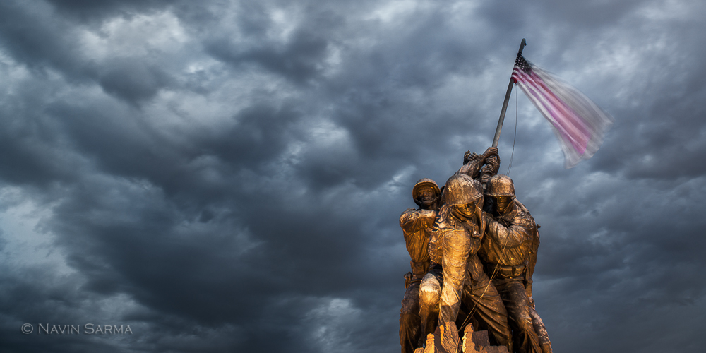 Dramatic, blue sunset clouds over the Iwo Jima Memorial