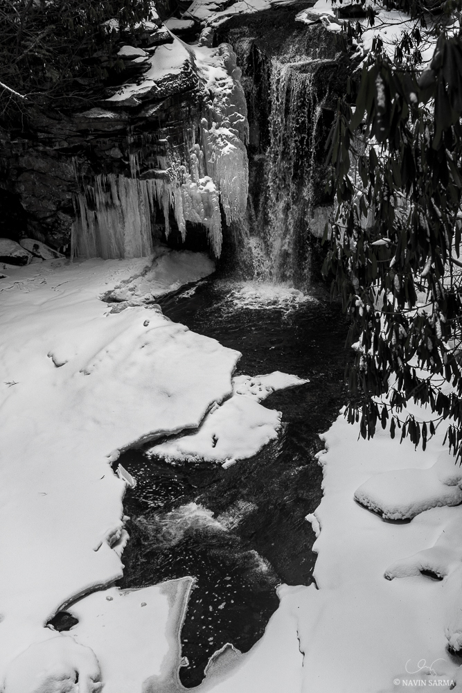 Pockets of water through the ice and snow form interesting shapes at the base of Elekala Falls, Shays Run #1