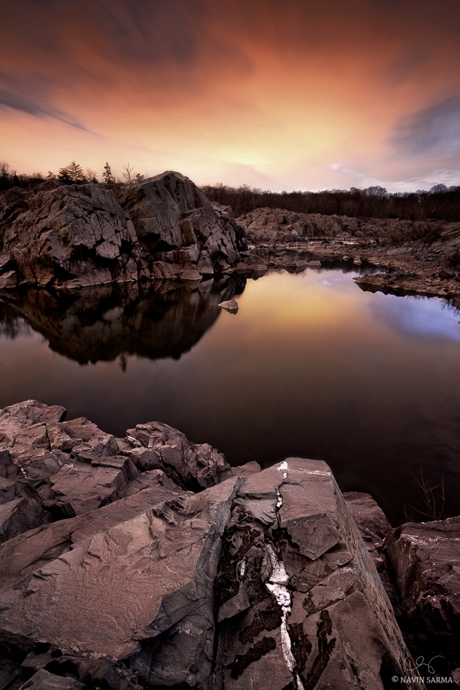 Just past sunset, an orange glow illuminates the scene at a peaceful section of Great Falls park