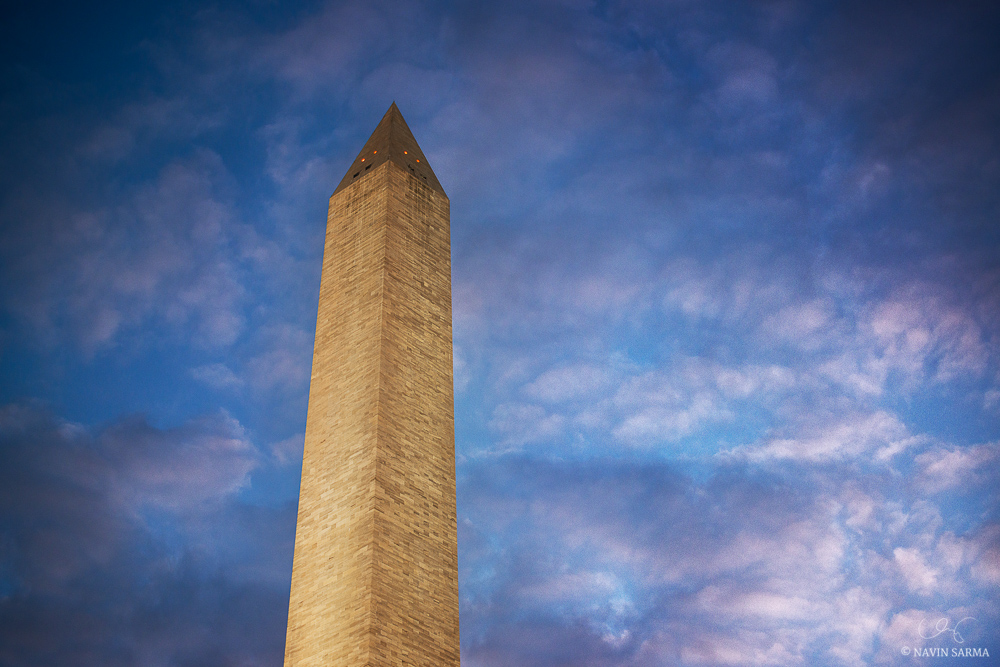 Pink, post-sunset clouds glow around the Washington Monument
