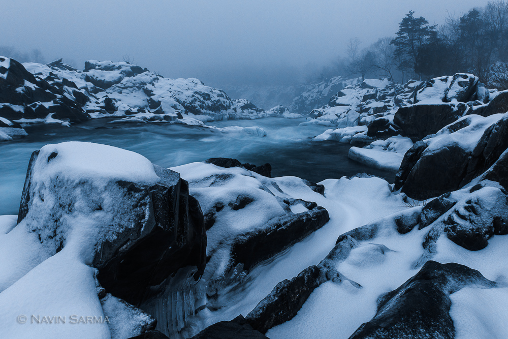 A snow squall hits Great Falls Park, blanketing it with snow and creating a mist on the scene