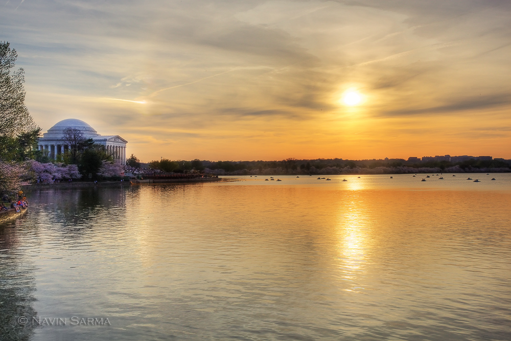 The sun sets at the Tidal Basin and Jefferson Memorial during the cherry blossom festival