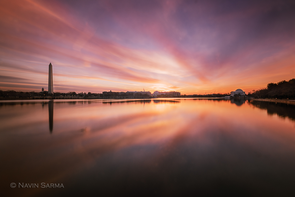 A radiant sunrise of warm colors at the Tidal Basin of Washington DC