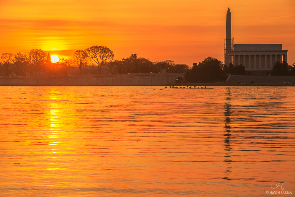 Rowers pass the Lincoln Memorial at dawn on the Potomac