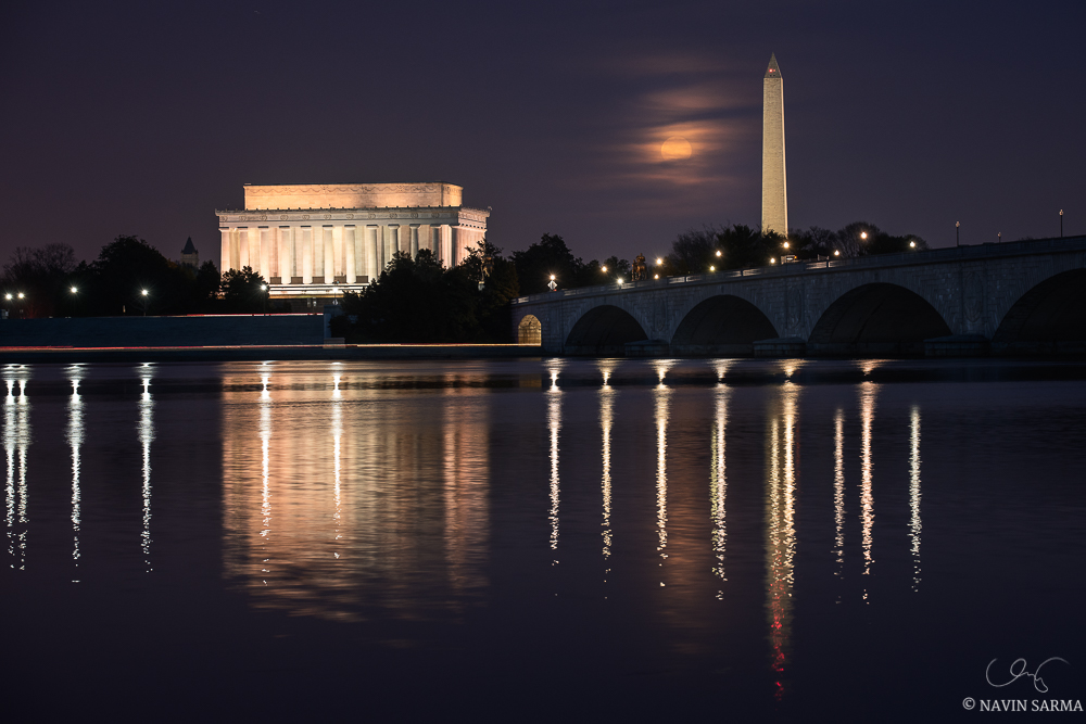 "The late winter's ""snow moon"" rises over the Memorial Bridge, Washington Monument, and Lincoln Memorial"