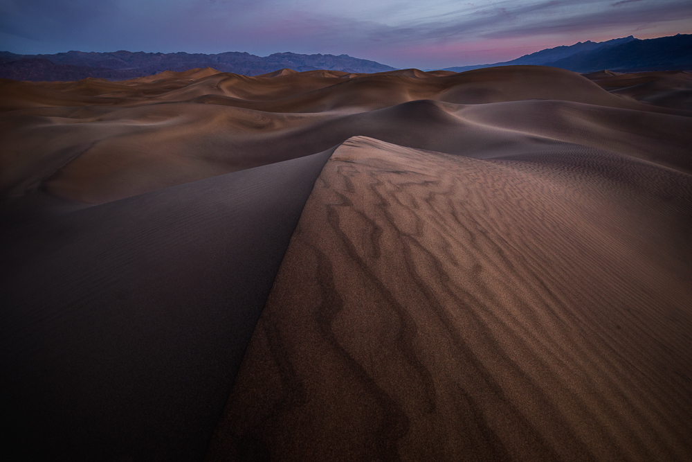 Sunrise highlights textures and shapes at Mesquite Flat Sand Dunes