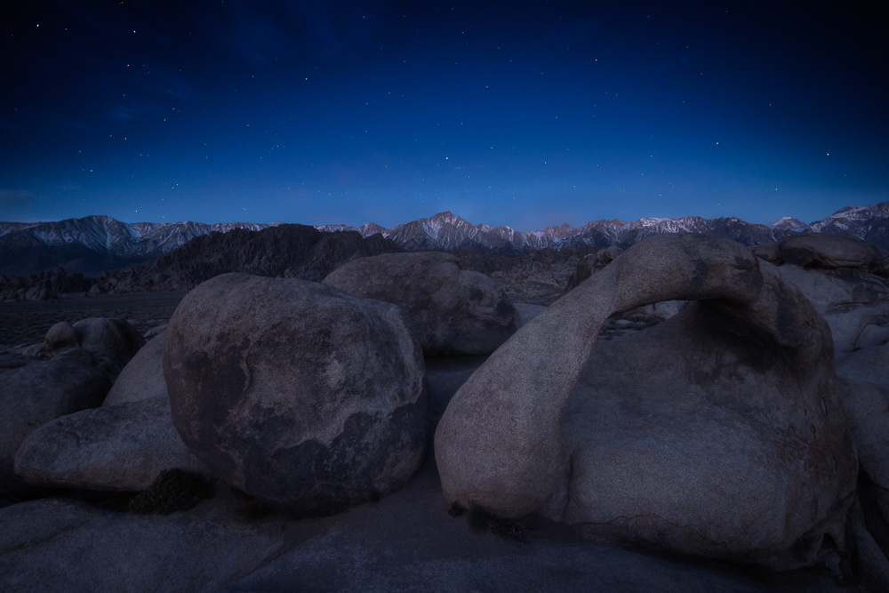 The sierra nevada range under stars before sunrise at Alabama Hills