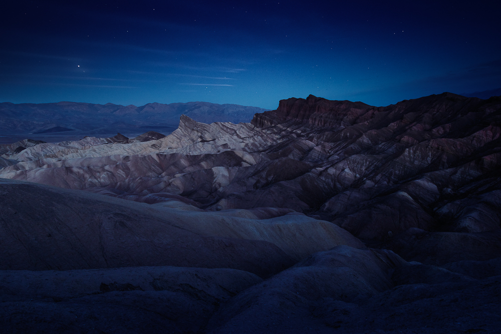 The beautiful shapes of badlands at Zabriskie Point before sunrise