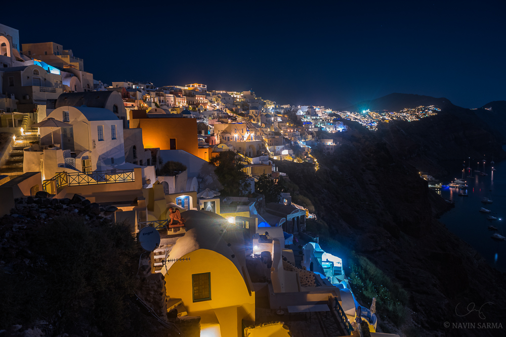 The rows of cave houses as seen from the tip of Oia at midnight