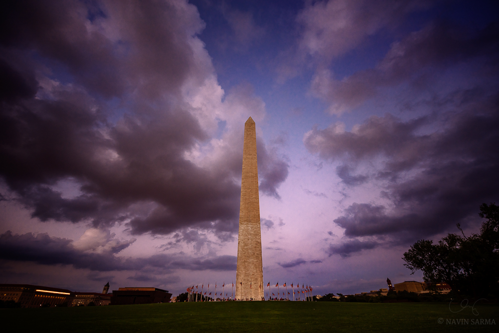 Cumulus clouds surround the Washington Monument during a classic summer sunset