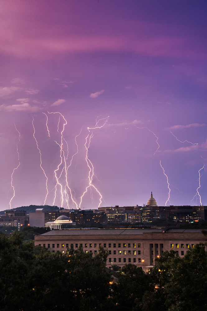 Lightning strikes over the U.S. Capitol and Jefferson Memorial in this composite of several lightning strike images