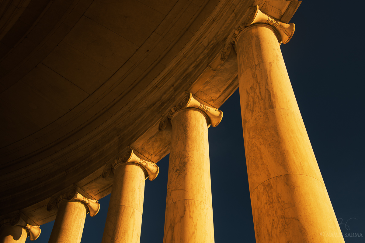 Late evening sun illuminates the pillars of the Jefferson Memorial