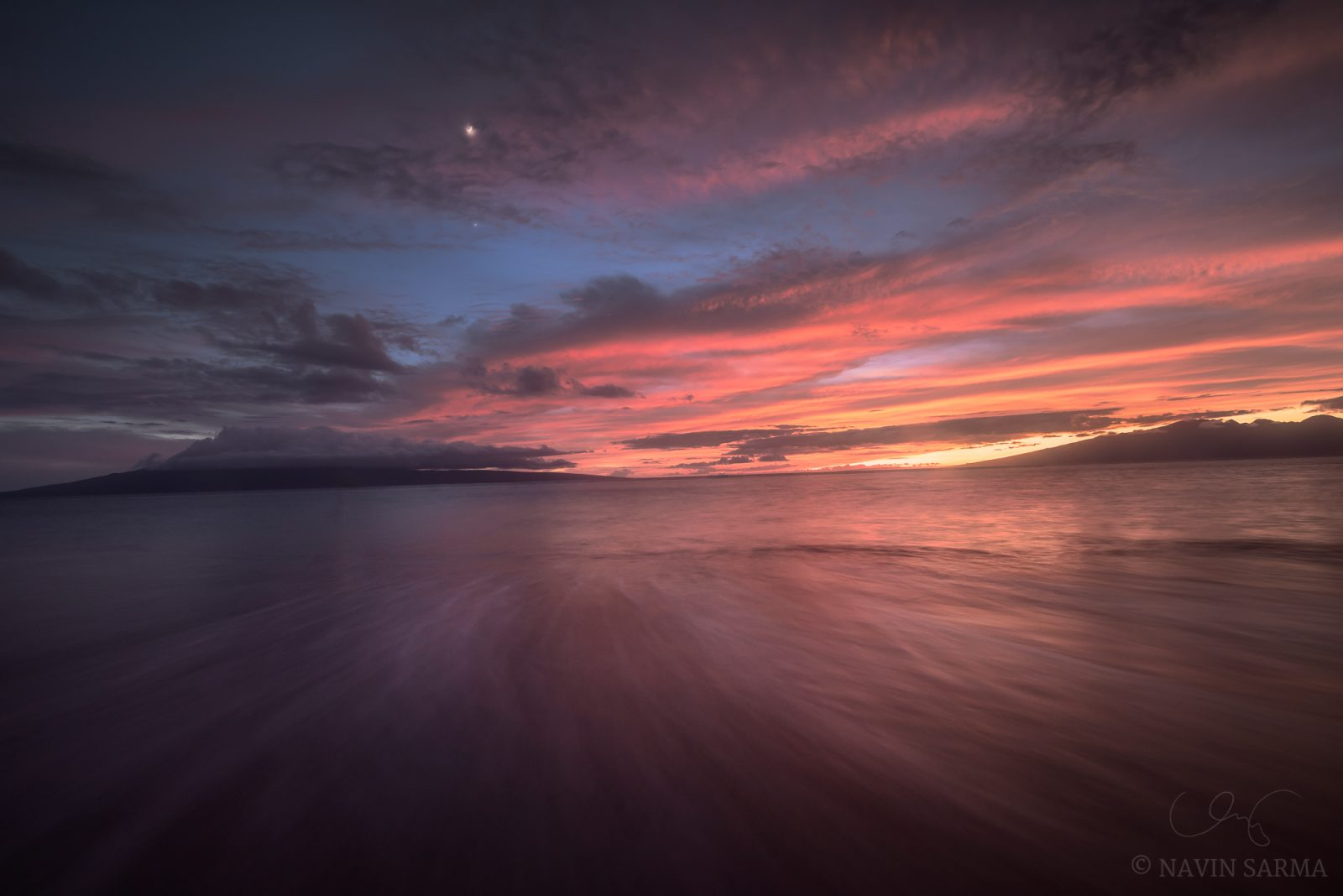 A blast of color at sunset under the crescent moon at Lahaina, Maui