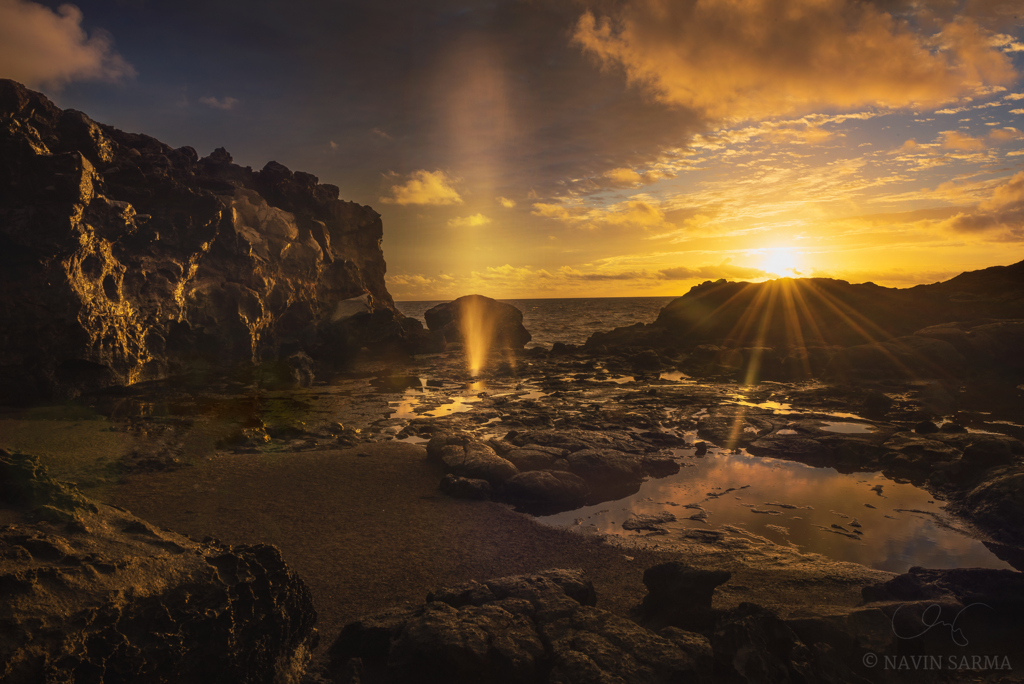 The sun rises above the shooting seawater of Nakalele Blowhole