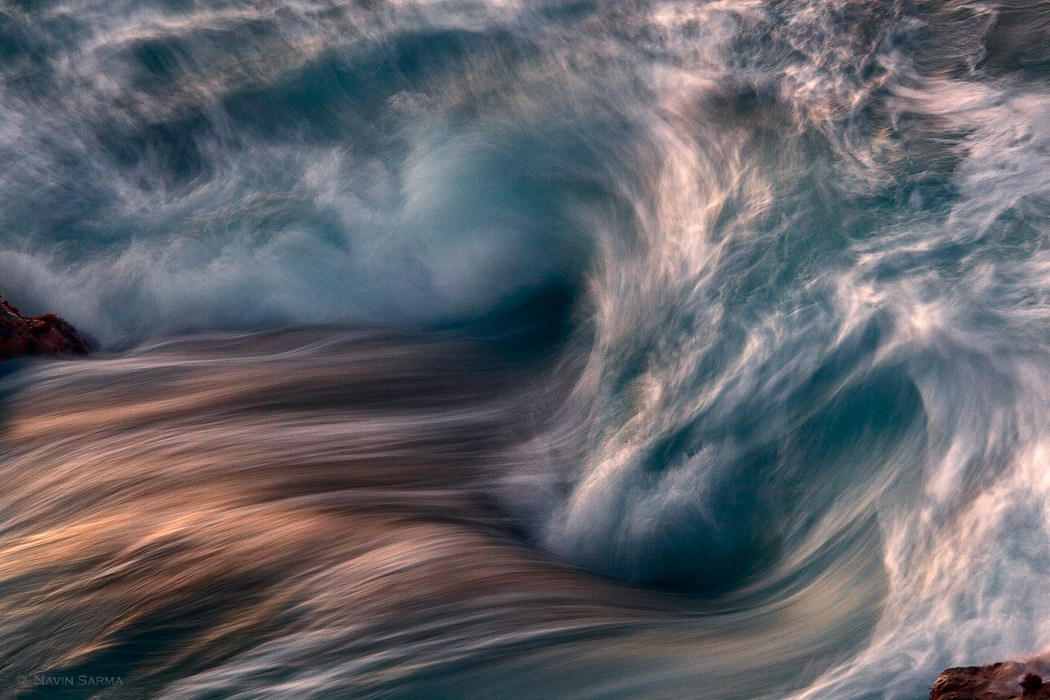 Momentum in wave formations gathers in interesting shapes and colors at King's Bath, Kauai.