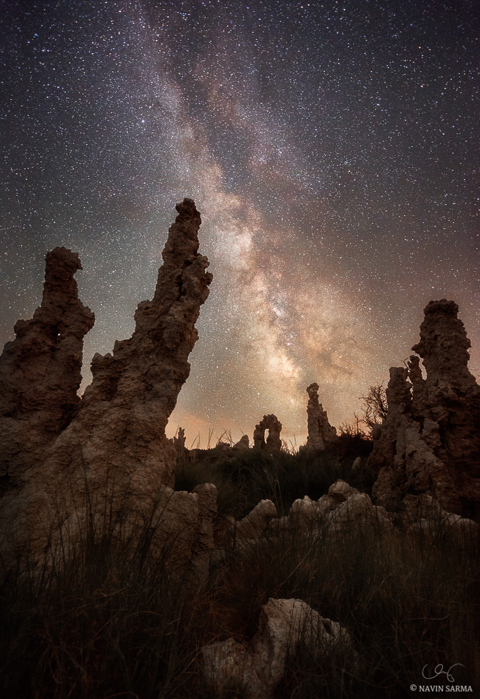 Smoke from a nearby wildfire scatters distant light from the sun and stars over Mono Lake, California.