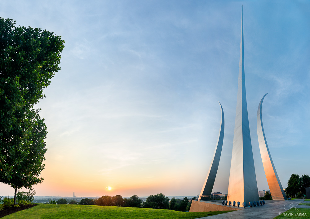 A perspective panorama blend shows the entire Air Force Memorial at sunrise