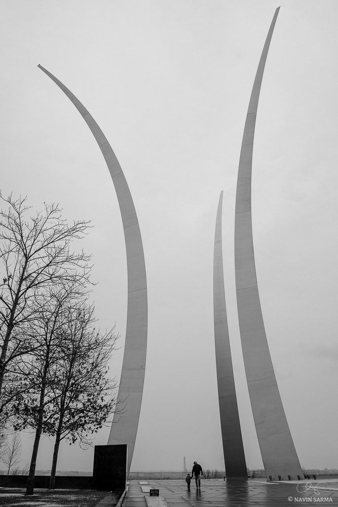 A man and son walk from their visit to the Air Force Memorial