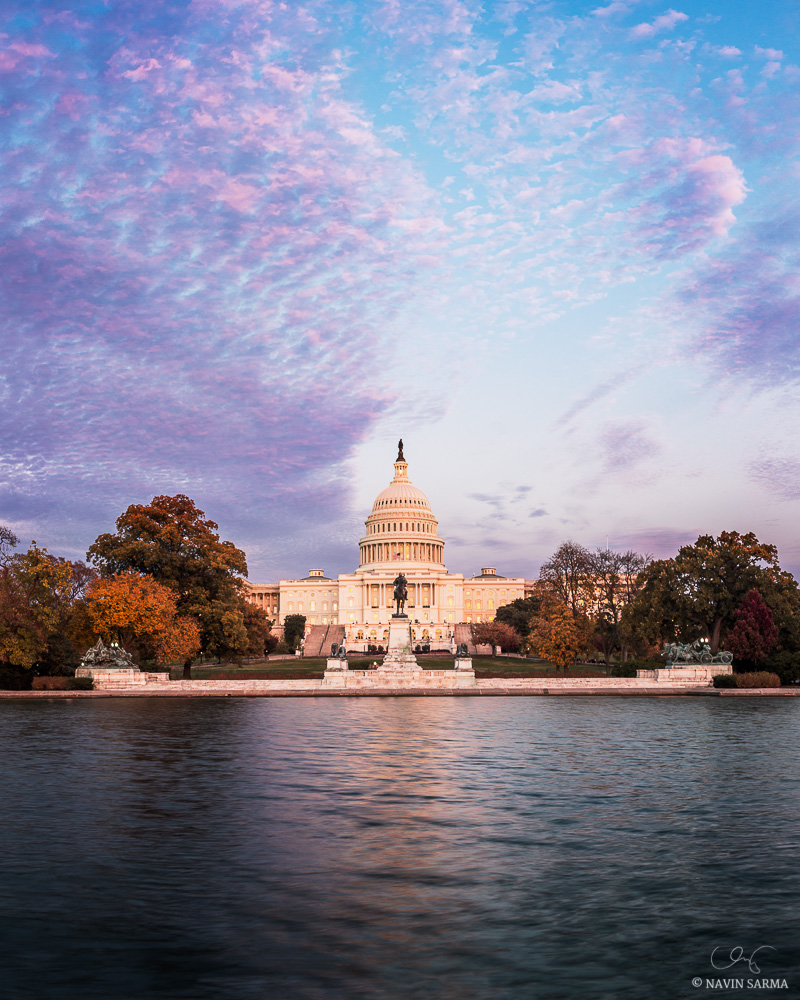 Peak fall foliage is showcased during a brilliant purple and blue sunset at the U.S. Capitol in Washington DC