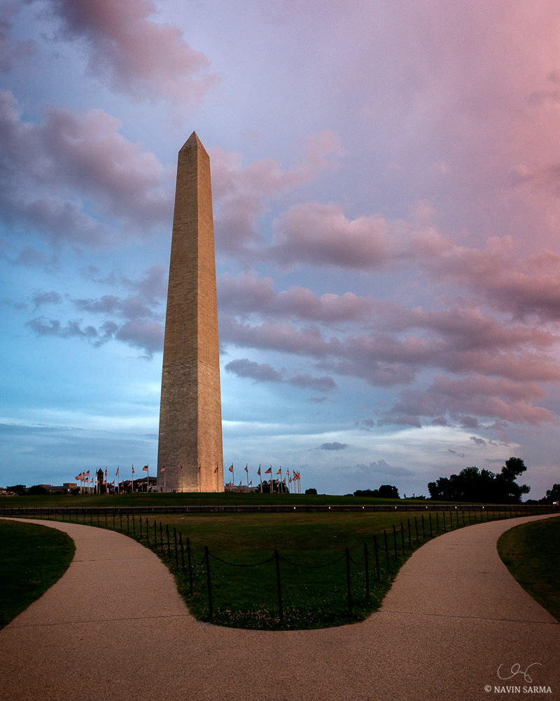 Paths separate forming symmetry during a pink sunset at the Washington Monument