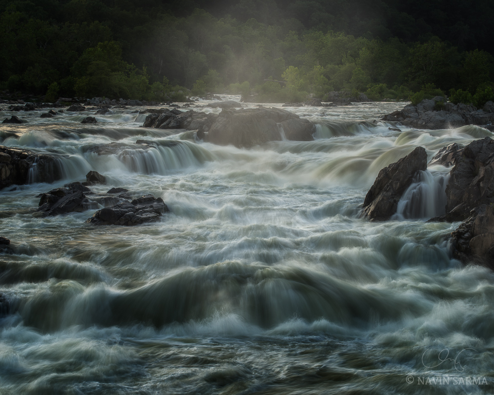 Mist rises from the running rapids of Great Falls on the Maryland side