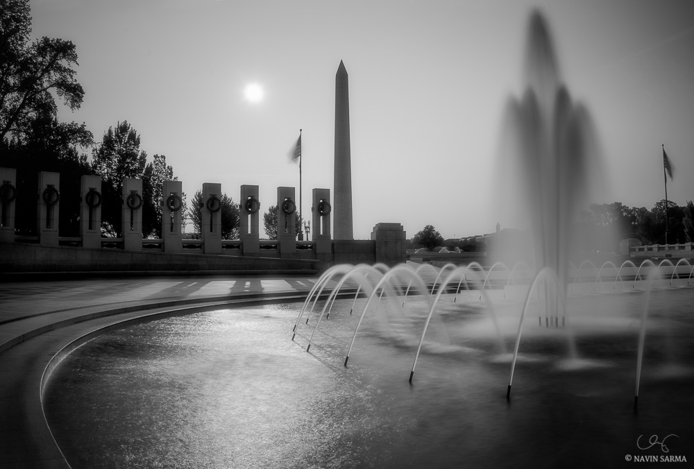 A radiant monochromatic sunrise  at the World War II Memorial