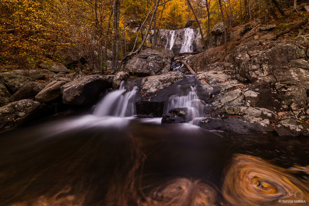 Water spins leaves in circles as it rushes down the Lower Falls of White Oak Canyon