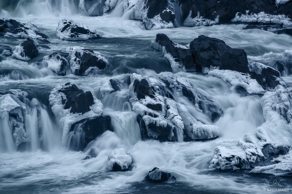 Water flows through the iced rocks of Great Falls Park