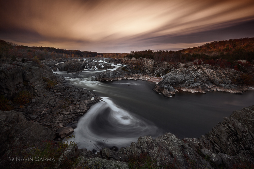 Water and clouds create shapes as they move through the scene at Great Falls National Park