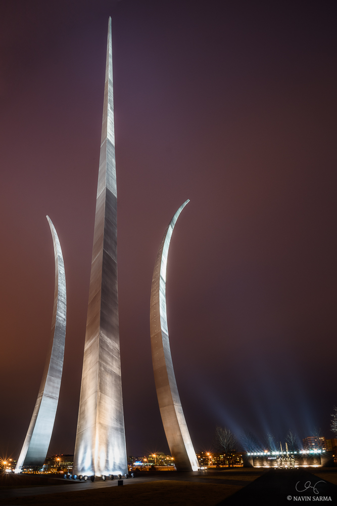 Under the purple post-sunset sky, the Air Force Memorial shines brightly under spotlights