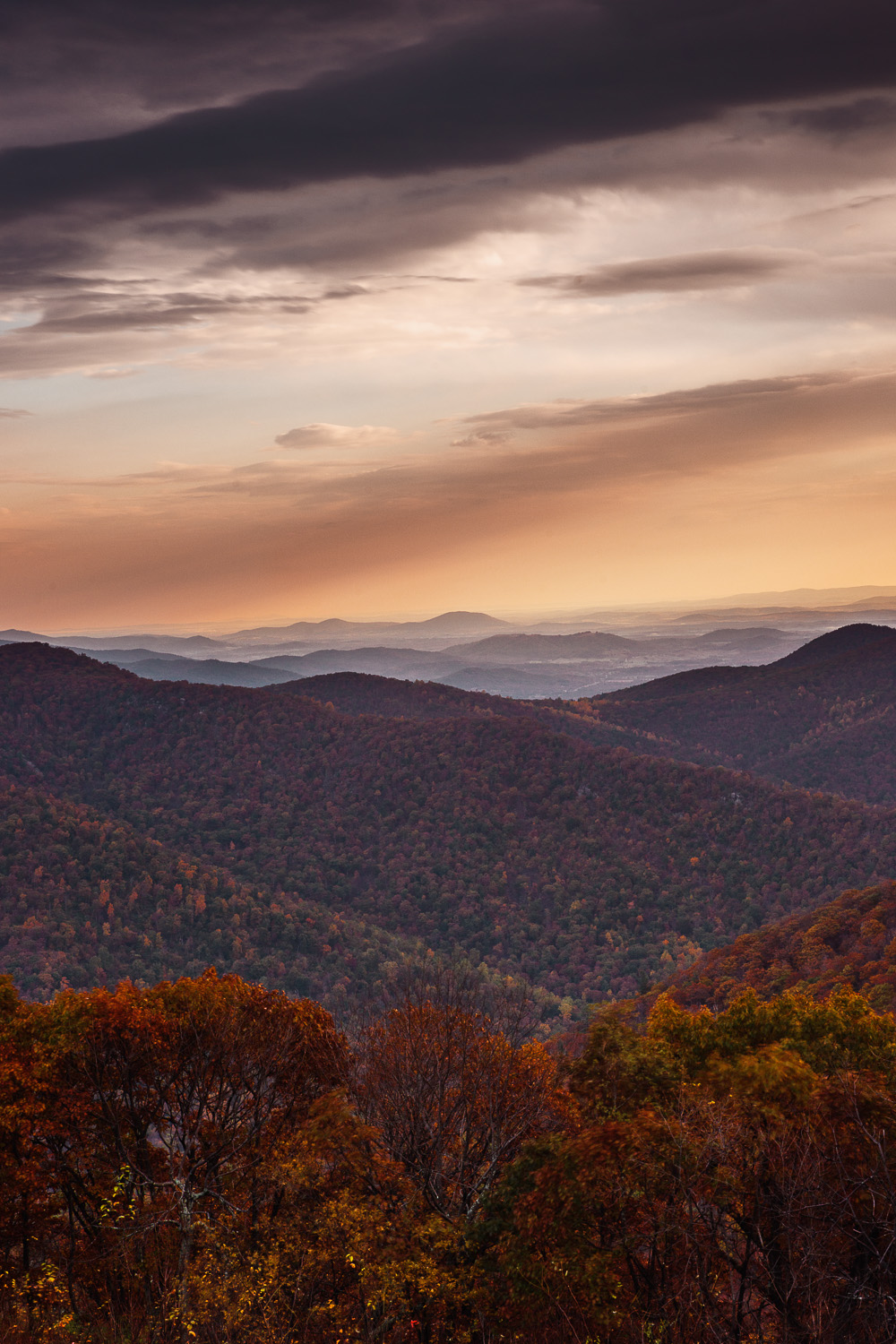 Rays of sun beam down on distant Shenandoah hills just past sunrise in Shenandoah National Park