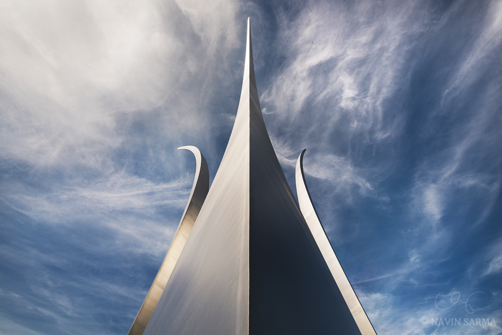 Looking up at the Air Force Memorial under wispy clouds and a blue sky