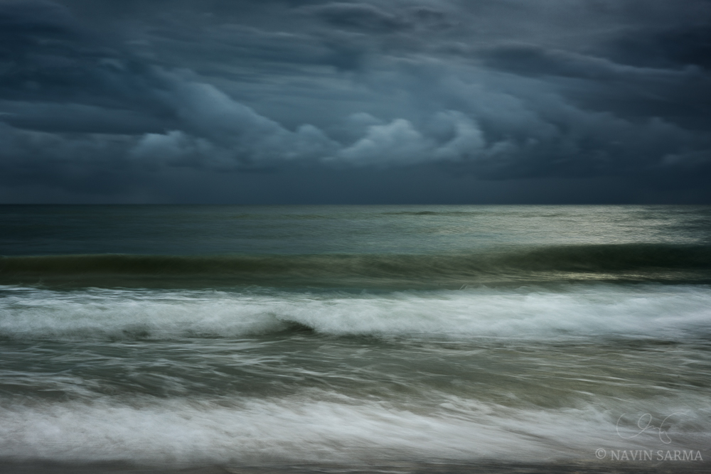 Somber blues and greens during a cloudy sunset on Clearwater Beach