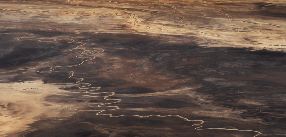 An abstract of salt flats and flowing creeks that sliver through the valley from Dante's View