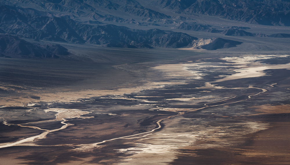 Mountains lead to the arid salt flats of Badwater Basin