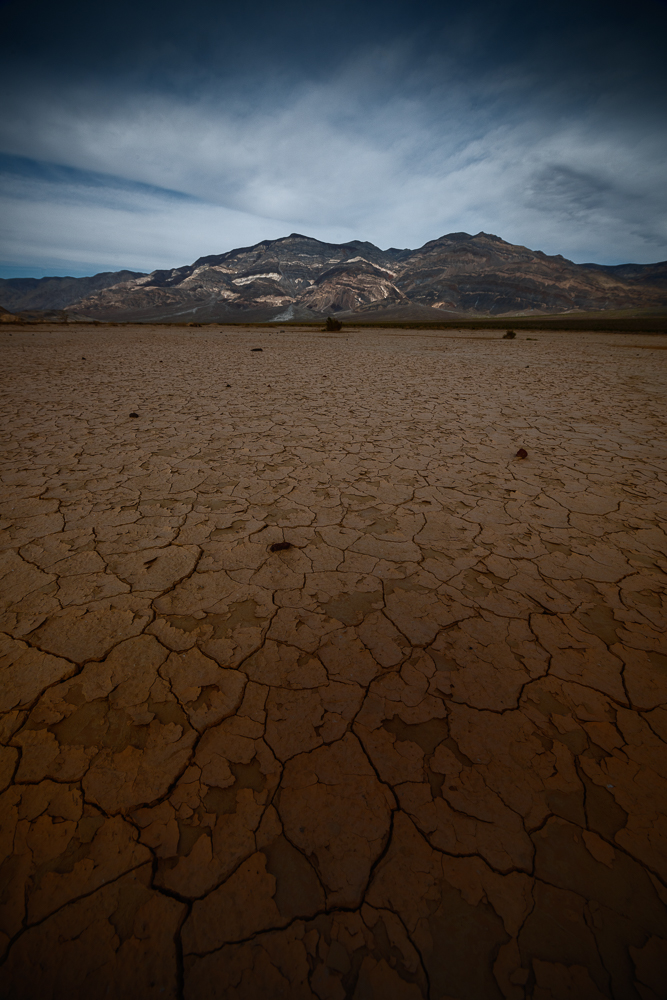 Cracks in the mud lead to volcanic rock and the Panamint Range