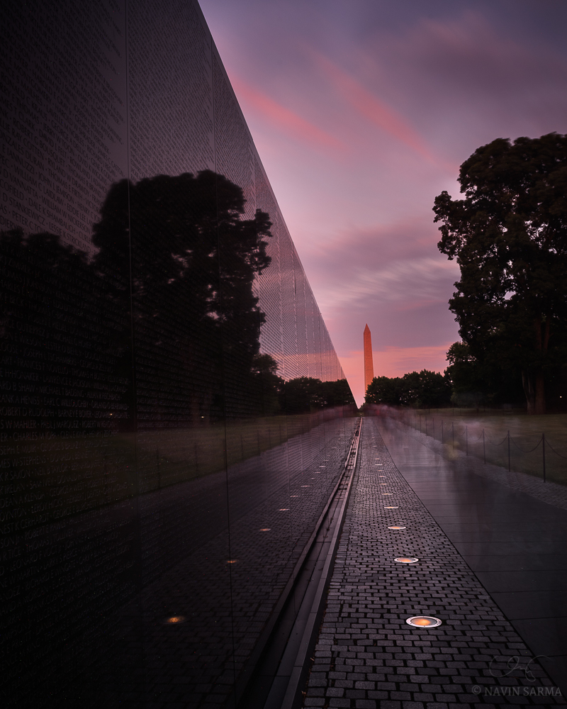 A long exposure at as sun basks the Washington Monument from the Vietnam Memorial