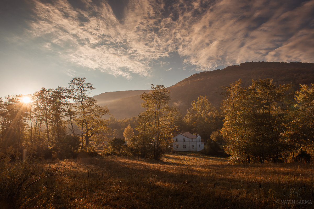 Autumn leaves, dramatic clouds and mountains in a back country road in West Virginia