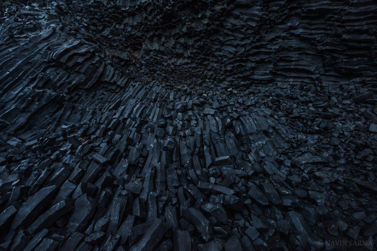 Basalt columns wind in beautiful shapes at the shores of Vik