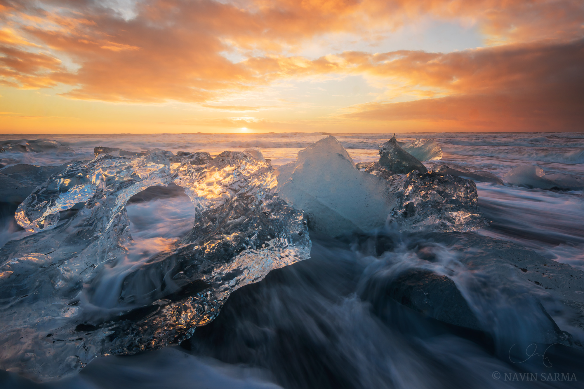 Being constantly barraged by water, Icebergs form beautiful shapes during a gorgeous sunrise at the black sand beach