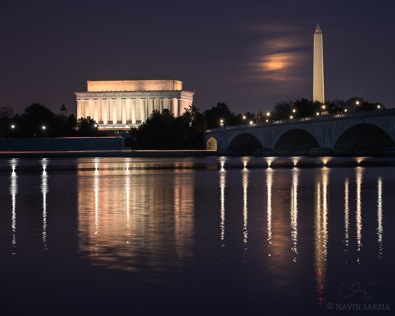 """The late winter's """"snow moon"""" rises over the Memorial Bridge, Washington Monument, and Lincoln Memorial"""